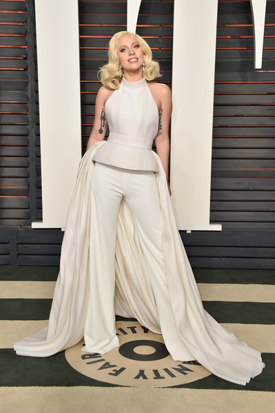 Lady Gaga Halter Top [vanity fair,oscar party,gown,wedding dress,bridal clothing,dress,fashion model,lady,fashion,haute couture,shoulder,flooring,beverly hills,california,wallis annenberg center for the performing arts,lady gaga,graydon carter - arrivals,graydon carter]
