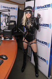 Lady Gaga snarled for the cameras in a dominatrix style bodysuit teamed with black pleather lace-up boots. For added spice, Gaga wore the boots over pleather leggings attached to garter straps.