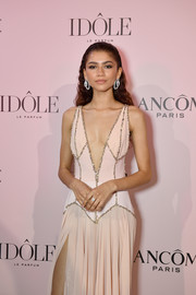 Zendaya Coleman paired a classic diamond ring with a pair of hoops, all by Chopard, for the launch of her new Lancome fragrance.