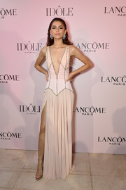 Zendaya Coleman looked super sultry in a pink Georges Hobeika gown with a deep-V neckline and a thigh-high slit at the launch of Lancome's new Idole fragrance.