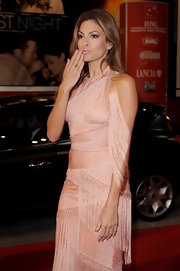 Nude nail polish is all the finish Eve needed in this blush pink gown.