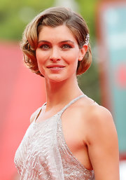 Walking the red carpet at The 68th Venice Film Festival, Vittoria Puccini looked like a screen siren of yesteryear with her hair styled in a glamorous retro updo.