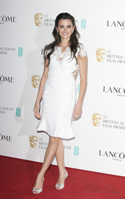 Penelope Cruz was the picture of elegance in a lace-panel LWD by Marchesa at the Lancome BAFTA nominees party.