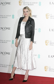 Lily Donaldson toughened up her delicate dress with a black leather jacket.