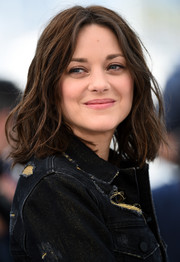 Marion Cotillard rocked messy-chic, center-parted waves at the Cannes photocall for 'From the Land of the Moon.'