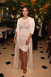 Ashley Graham polished off her look with a pair of barely-there sandals.