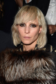Noomi Rapace looked edgy at the Lanvin fashion show with her bleached, barely-there waves and eye-skimming bangs.