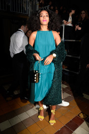 Solange Knowles went for a conservative, matchy-matchy look with this bright teal Lanvin blouse and skirt set during the label's fashion show.