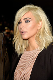 Kim K showed off new platinum locks at the Lanvin show.