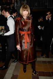 Anna Wintour looked as stylish as ever in a brown trenchcoat with a red belt and piping during the Lanvin fashion show.