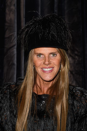 Anna dello Russo, the woman of many hats, chose this feathered black number for the Lanvin fashion show.