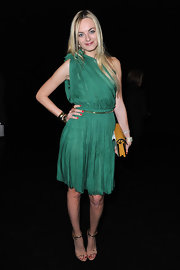 Virginie accessorized her pleated dress with metallic strappy sandals.