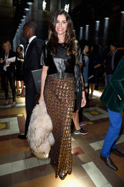 Christina Pitanguy dressed up her leather top with a textured metallic maxi skirt.