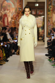 Bella Hadid was the picture of luxury in a cream-colored coat with a fur collar and gold buttons while walking the Lanvin runway.
