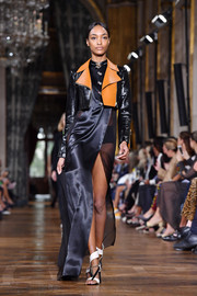 Jourdan Dunn looked sultry in a high-slit black gown with sheer side panels while walking the Lanvin runway.