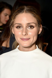 Olivia Palermo opted for a casual center-parted ponytail when she attended the Lanyu fashion show.