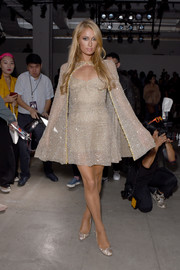 Paris Hilton glammed it up in a caped crystal dress by Lanyu during the brand's fashion show.