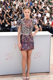 Adele Exarchopoulos donned a Louis Vuitton printed mini dress with tulip sleeves for the 'Last Face' photocall.