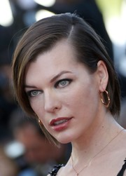Milla Jovovich wore an edgy side-parted short 'do at the Cannes premiere of 'The Last Face.'