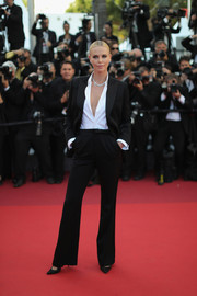Charlize Theron stood out in a sea of dresses in this black Dior Couture pantsuit during the Cannes premiere of 'The Last Face.'