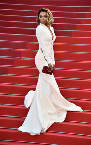 Kat Graham swept into the Cannes premiere of 'The Last Face' wearing a perfectly tailored white fishtail gown by Steven Khalil.