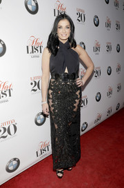 Dayanara Torres went for sexy glamour in a black halter gown with a sheer, embellished skirt during Latina's 20th anniversary celebration.