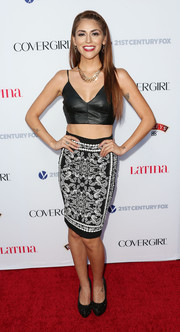 Melissa Barrera paired a black-and-white paisley-print skirt with her crop-top for a chicer finish.