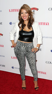 Raquel Cordova looked funky and sexy in leopard-print leggings and a tight-fitting crop-top during the Hollywood Hot List party.