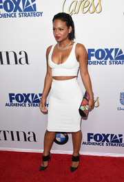 For a splash of color to her white outfit, Christina Milian accessorized with a graphic-print clutch by Patricia Field.