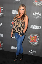 Carmen Electra paired her sequin clad top with skin tight jeans and peep toe ankle boots.