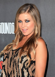 Carmen Electra attended the launch of 'Guitar Hero' with sleek straight locks parted down the side.