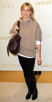 Julie Bowen attended the Gucci Children's Collection launch in a pair of black leather flat boots. The casual footwear matched the easy vibe of her slouchy nude sweater.