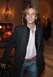 Andrea Casiraghi added a touch of formality to his jeans and white shirt with a tailored charcoal coat.