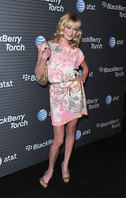 Nicholle paired her brightly-printed dress with metallic, textured peep toe pumps.