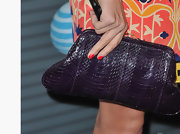 Heather Tom paired her printed dress with a purple textured clutch.