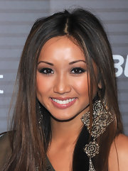 Brenda Song showed off her gold dangle earrings while hitting the Blackberry party.
