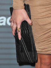 Kristin Cavallari showed off her textured leather clutch while attending the launch of Blackberry Torch.