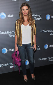 Amber dressed up her jeans and tee with a gold sequined jacket.