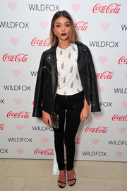 Sarah Hyland topped off her edgy outfit with a black leather biker jacket by Wildfox.