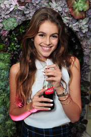 Kaia Gerber looked very pretty with her long waves at the Wildfox Loves Coca-Cola collection launch.