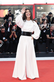 Alessandra Mastronardi kept it minimal in a white wide-leg jumpsuit by Alberta Ferretti at the Venice Film Festival screening of 'The Laundromat.'