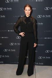 Darby Stanchfield kept it demure in a black pussybow blouse and a pair of wide-leg trousers at the Laura Basci and de Sede LA showroom opening.
