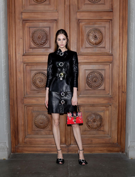 Laura Love Skirt Suit [clothing,black,fashion model,leather,fashion,shoulder,dress,footwear,textile,fashion design,cruise 2018 - arrivals,laura love,palazzo pitti,florence,italy,gucci,fashion show,gucci cruise 2018]