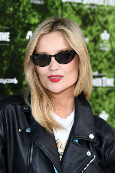 Laura Whitmore Red Lipstick [eyewear,sunglasses,hair,face,street fashion,hairstyle,cool,blond,leather,lip,laura whitmore,hyde park,barclaycard exclusive area,england,london,barclaycard presents british summer time hyde park,barclaycard presents british summer time]