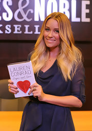 Author Lauren Conrad wore an 18-karat yellow gold baguette diamond leaf ring at a signing for her new books 'Sugar And Spice and Lauren Conrad Style Guide' at The Grove.
