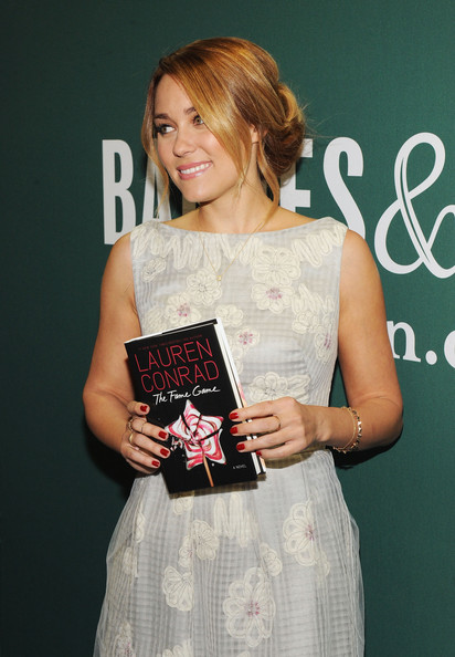Lauren Conrad wore her hair in a lovely pinned-up style with loose face-framing strands while at a signing for her new book.