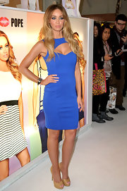 Lauren wore a figure-hugging blue dress with cutout details from her own clothing collection.