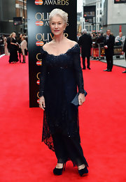 Dame Helen Mirren showed off just a touch of skin with this elegant navy gown with beaded lace overlay.