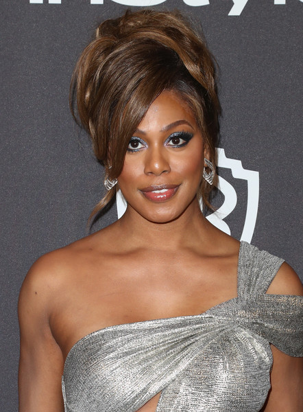 Laverne Cox Beehive [hair,hairstyle,eyebrow,chin,beauty,blond,brown hair,shoulder,lip,long hair,laverne cox,beverly hills,california,the beverly hilton hotel,instyle,golden globes,warner bros.,arrivals,party]