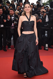 Marion Cotillard showed off her trim abs in a black halter crop-top by Chanel Couture at the 2019 Cannes Film Festival screening of 'La Belle Epoque.'